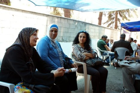 Umm Kamel (left) tells the story of her family's eviction from Sheikh Jarrah, East Jerusalem. Her husband died as a direct result of their forced displacement.